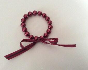 """""""Renaissance"""" Burgundy glass beaded bracelet."""