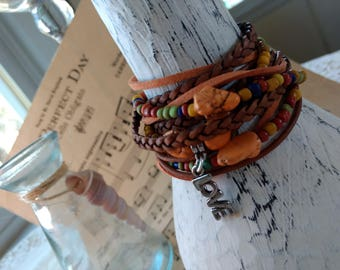 Lovely Boho Leather and Bead Wrap Bracelet, Multi Strands of Leather in shades of Natural tans and multi colored indonesian seed beads