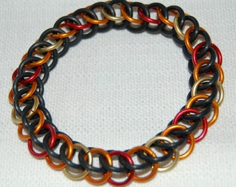 Stretchy chainmaille bracelet in fire colours