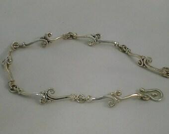 Sterling silver custom link bracelet.