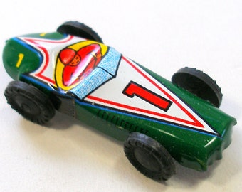 60s Mini tin toy race car in green, from Japan. Number 1. Vintage fun!
