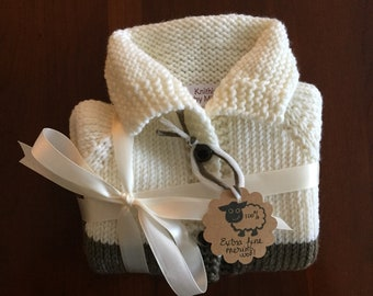 Hand-knit baby cardigan in gender neutral tones made with 100% superfine merino wool