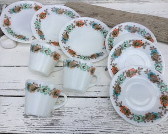 Three trios of Pyrex JAJ Carnaby Tempo cups saucers and side plates from the 1970s