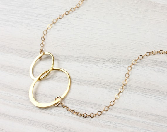 rings in gold double asp ring news cartier pink necklace love
