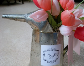 Rustic oil can filled with spring tulips