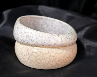 Married Bangle pair. Two asymmetric, stone look lucite cuff bangles.