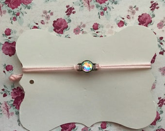 Dainty pink bracelet with multicolor charm