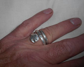 Silver snake ring with Diamond eyes. Size W now but can be sized for free.