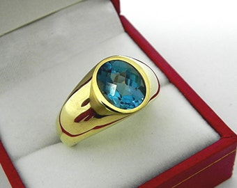 AAAA Teal Blue London Blue Topaz   10x8mm  3.41 Carats   Checkerboard cut in  Heavy 18K Yellow gold MAN'S ring 20 grams. 2585