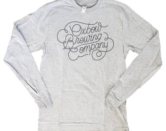 Grey on Heather Grey Long Sleeve Oxbow script T