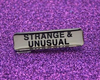 Strange & Unusual Enamel Pin Badge
