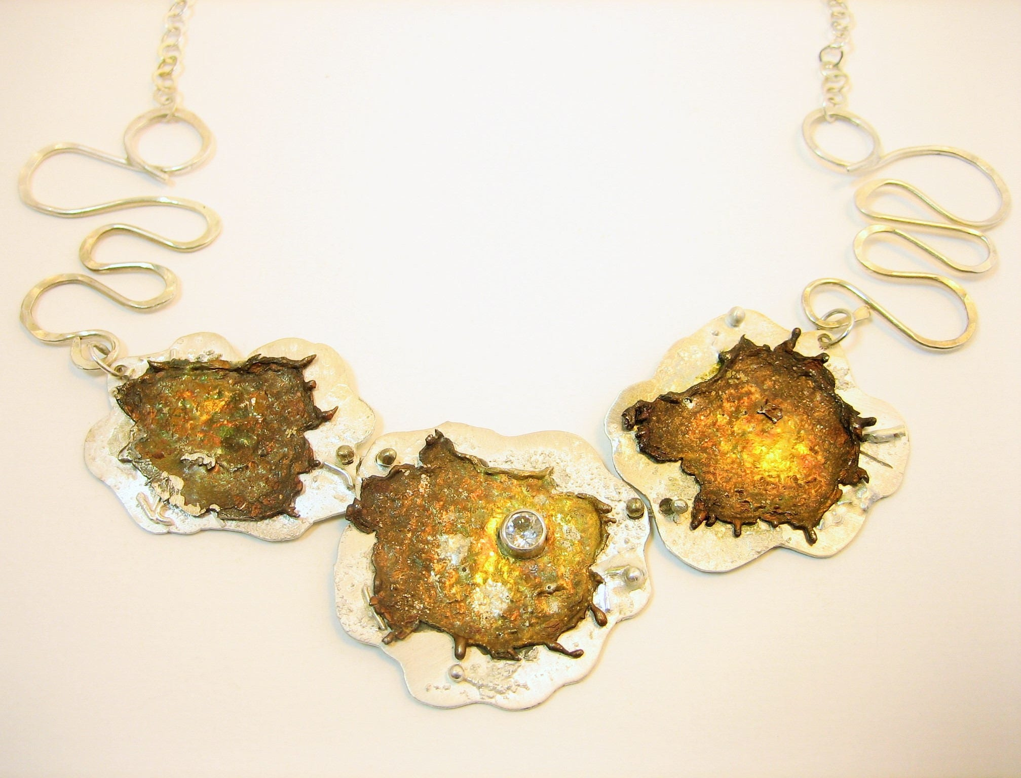 One-of-a-kind unique star necklace, silver starburst necklace, artisan two toned necklace, white topaz necklace, silver and gold necklace