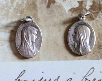 2 old  religious medals