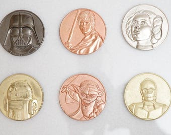 Star Wars Collector Coins: Darth Vader, Yoda, Luke Skywalker, Leia, C3p0, R2d2.