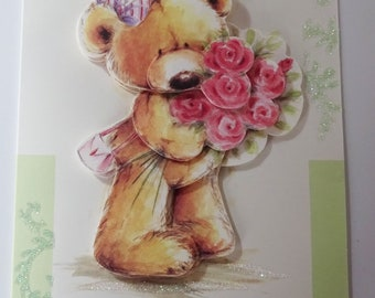 Birthday Wishes Bear holding a bunch of roses, wearing a pink shoulder bag and hair ribbon