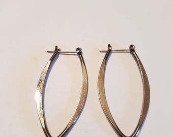 Gun metal silver hoop earrings. Oblong silver earrings
