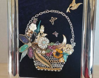 Costume vintage jewelry frame art of a basket.