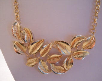 Gold Leaves Pendant Bib Necklace on a Gold Tone Chain