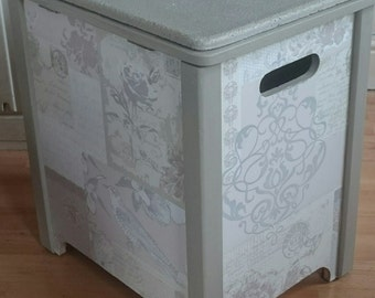 Pretty storage stool. Painted in Frenchic Posh Nelly chalk paint. Decoupaged with pretty paper.