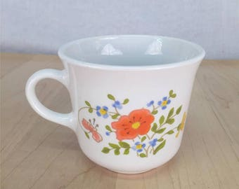 """1 Coffee Mug   Corning Corelle """"Wildflower""""   1980s orange blue green floral pattern   3"""" inches tall   Very good used condition"""