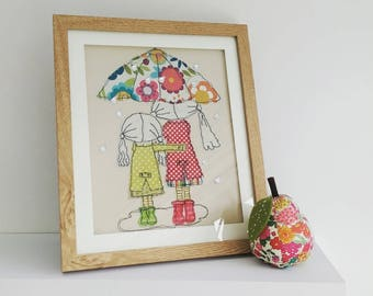 Singing In The Rain framed embroidery by Lillyblossom. Two sisters or best friends sheltering under an umbrella.   Sequin raindrops