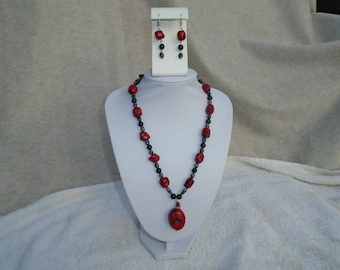 Red coral and snowflake obsidian necklace and earrings