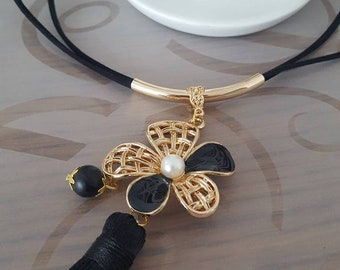 Necklace black and gold, flower and black tassel