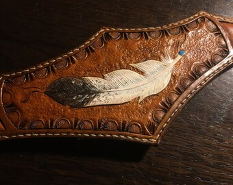 Bronc nose band with a cut out feather