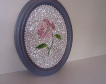 Wooden table with mosaic rose