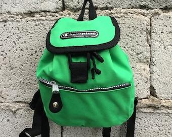 Champion Backpack/ Vintage/ 90s/ black and green/ adjustable straps/ inside zip/ lined/ two pockets/ 19 cm x 18 cm