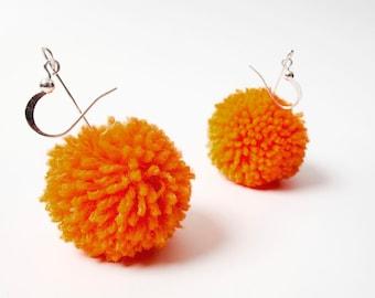 Big pompom earrings