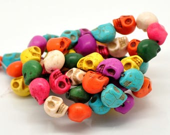 Set of 5 howlite beads head skull red 9, 5 X 7, 5mm