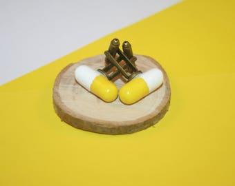 Yellow and white pill cufflinks