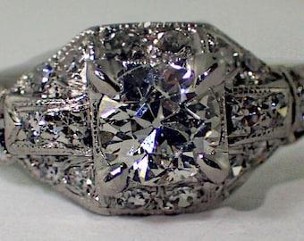 Platinum Engagement Ring with 0.45 Carat Round European Cut Diamond , Circa 1965