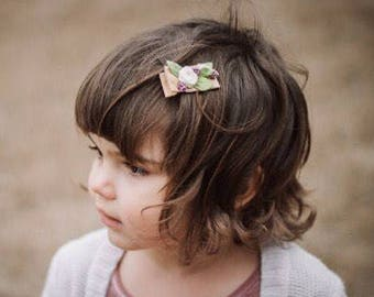 Bitty floral clip ivory roses