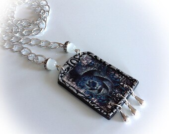 Necklace rectangular pendant, ceramic, blue imitation.