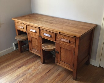 Early 1900's quarter sawn oak and maple lab desk with swing stools by C Christiansen of Chicago.