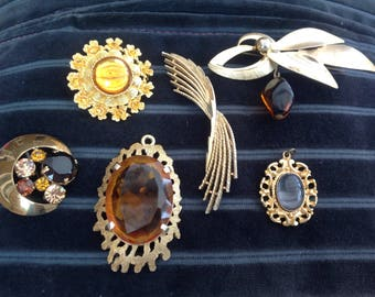 Set of five vintage brooches and one vintage charm.