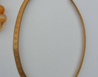 Beautiful and unusual vintage gold tone collar/choker/necklace with embossed flower design.