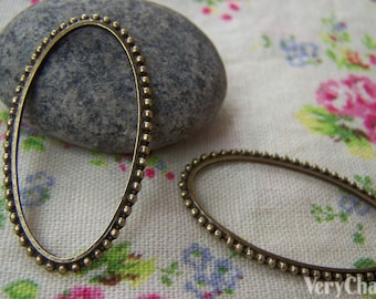 10 pcs of Antique Bronze Oval Rings Charms 23x42mm A358