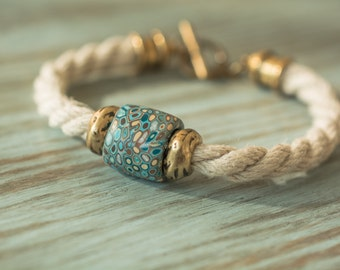 Natural Hemp Cord Bracelet with handmade Samunnat bead from Nepal and brass accents