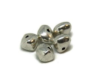 5 irregular silver-plated beads 9x9mm