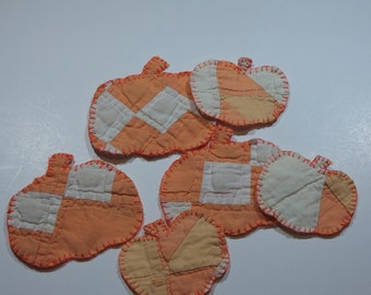 Ornaments pumpkins cutter quilt vintage quilted Christmas andHalloween oranges cream abstract folk art fabric textiles embroidered
