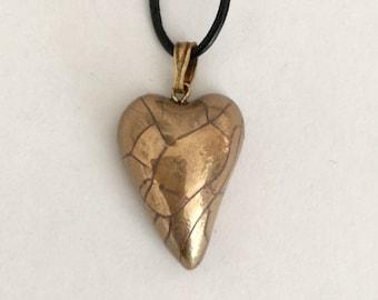 Small gold heart pendant.