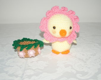 Cuteness overload with this little duckling dressed as a flower sitting in her flowerpot by Liz