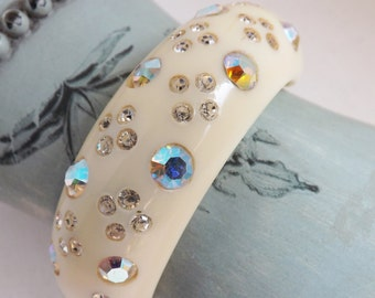 Vintage signed Weiss hinged clamper bracelet or cuff celluloid ivory cream w AB rhinestones thermoset plastic