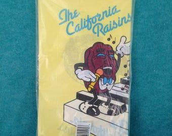 "The California Raisins Plastic Tablecloth 1988 CALRAB Amscan 54"" by 102"" in Original Packaging"