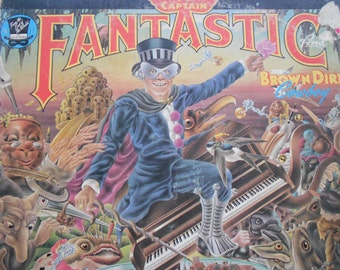 Elton John - Captain Fantastic and The Brown Dirt Cowboy- vinyl record with lyrics booklet and scraps booklet
