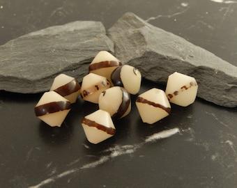 set of 5 spinning papaya seed beads