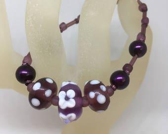 Bracelet Handmade Purple Glass Lampwork Bead Flower and white spots by JulieDeeleyJewellery on Etsy